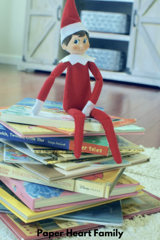 Pose your elf on the shelf with a tree made out of books!