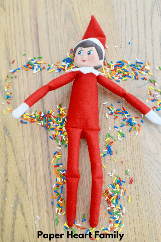 This Elf on the Shelf has the right idea. Making a sprinkle angel is much more fun!