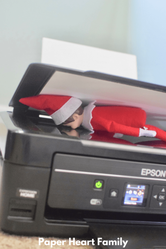 Silly Elf on the Shelf is trying to scan and print himself!